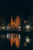 Illuminated Buildings by Canal at Night in Bruges Royalty Free Stock Images