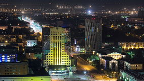 Illuminated builrings and traffic on the roads timelapse from rooftop at night in Astana. Kazakhstan capital stock footage