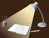 Illuminated bulb to the desktop Royalty Free Stock Photography