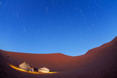 Illuminated camp in Sahara desert in nights Stock Photography