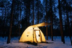 Illuminated camping tent at night. In a forest Royalty Free Stock Image