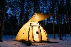 Illuminated camping tent at night. In a forest royalty free stock images