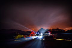 Illuminated camping tents at night in alpin zone. Illuminated camping tents at foggy night in alpin zone Stock Image