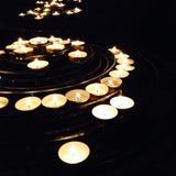 Illuminated Candles on Black Background Stock Photo