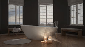 Illuminated candles inside a minimalist bathroom, spa zen interior design stock photography