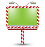 Illuminated candy cane billboard on white Stock Photography