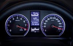 Illuminated car dashboard. stock image