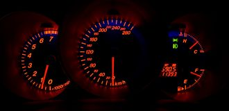 Illuminated car dashboard Stock Photo