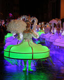 Illuminated Carnival Dancers. AALST, BELGIUM, FEBRUARY 7 2016: Unknown participants colorfully illuminted in costume during the annual carnival parade in Aalst Stock Photo