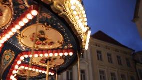Illuminated carousel in old city at night stock footage
