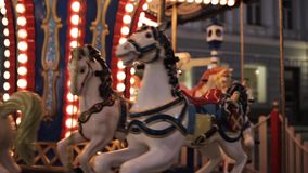 Illuminated carousel in old city at night stock video footage