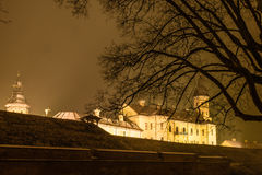 Illuminated castle framed by trees covered with snow and tree br Stock Photos