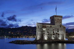 Illuminated castle by the sea in Rapallo Stock Photography
