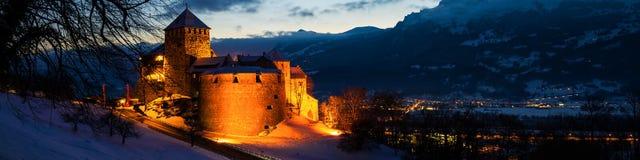 Illuminated castle of Vaduz, Liechtenstein at sunset - popular landmark at night royalty free stock photos