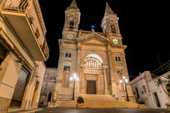 Illuminated Cathedral in Alberobello, Italy. ALBEROBELLO, ITALY - MAY 15, 2015: night view of Illuminated Cathedral in Alberobello, Italy. Alberobello is famous royalty free stock images