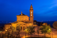 Illuminated catholic church at dawn. Royalty Free Stock Photo