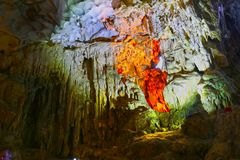 Illuminated Cave Landscape with water, Ha Long Bay, Vietnam Stock Image