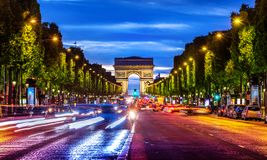 Illuminated Champs Elysee. And view of Arc de Triomphe in parisian evening, France stock photos