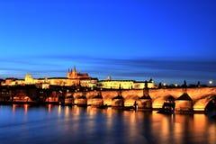 Illuminated Charles Bridge with Prague Castle at Dusk, Prague Royalty Free Stock Photos