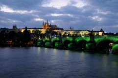 The illuminated charles bridge and the prague castle at night Royalty Free Stock Photography