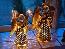 Illuminated Christmas angel decoration. Beautiful festive illuminated Christmas angel decoration made of brass Stock Photo