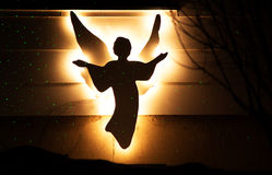 An illuminated Christmas angel. An illuminated silhouette of a Christmas angel outdoors Stock Photography