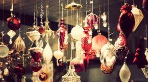 Illuminated Christmas fair kiosk with loads of shining decoration merchandise Stock Images