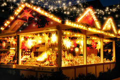 Illuminated Christmas fair kiosk Stock Photography