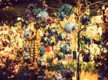 Illuminated Christmas fair kiosk with loads of shining decorations Stock Photos