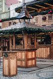 Illuminated Christmas fairground with wooden kiosk with a lot of bright decorations, without logos. Market Square, Wroclaw, Poland. Holiday concept royalty free stock photos