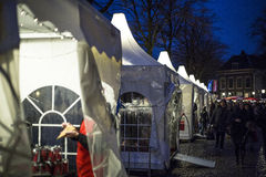 Illuminated Christmas stalls with People Royalty Free Stock Photos