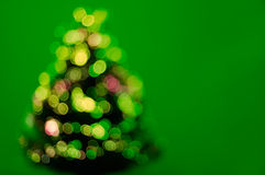 Illuminated christmas tree. Christmas tree with many decoration lights on green background with empty space Stock Photo
