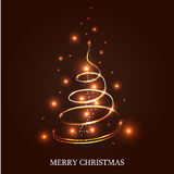 Illuminated Christmas tree. On a dark brown background Stock Photo