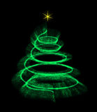 Illuminated Christmas tree isolated with a star. Stock Images