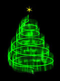 Illuminated Christmas tree isolated with a star. Royalty Free Stock Image