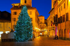 Illuminated Christmas tree in Old City of Alba. Stock Photography