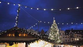 Illuminated christmas tree and old city fair stock video footage