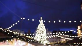 Illuminated christmas tree and old city fair stock footage