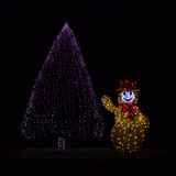 Illuminated Christmas tree and Snowman Stock Photo