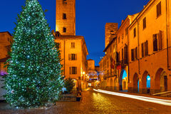 Illuminated Christmas tree on town square in Alba, Italy. Royalty Free Stock Images