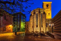 Illuminated church on town square in morning. Stock Images