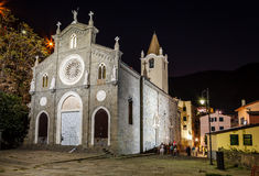 Illuminated Church in the Village of Riomaggiore at Night Stock Image