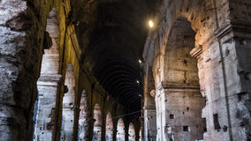 Illuminated circular galleries of Colosseum in Rome, Italy royalty free stock photography