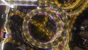 Illuminated circular Nanpu road junction at night. Traffic circle. Shanghai, China. Aerial vertical top-down view. Illuminated circular nanpu road junction at stock video footage