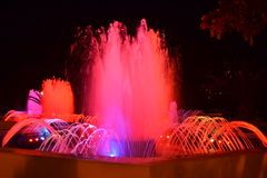 Red lighted fountains Stock Images