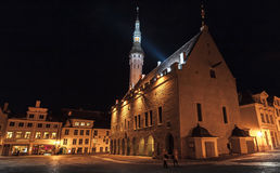Illuminated city hall at night. Old town of Tallinn Stock Image