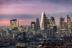 The illuminated City of London, financial district. Just after sunset Royalty Free Stock Photo