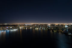 Illuminated city over the bay Royalty Free Stock Photo
