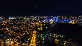 Illuminated city skyline at night Stock Photography