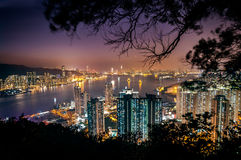 Illuminated cityscape and Victoria Harbour as seen from Devil's Peak, Kowloon Stock Photos